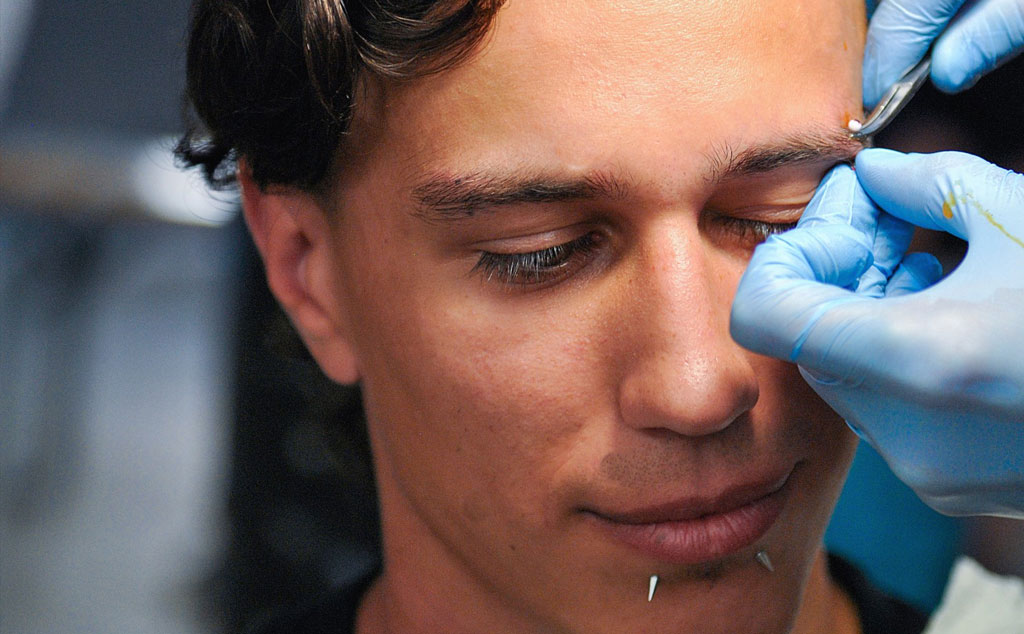 How much do face piercings hurt